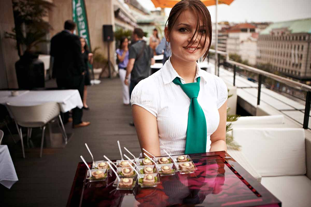 Beautiful hostess serving clients during an event professionally organized by Maxin PRAGUE