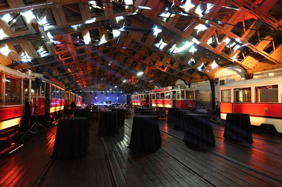 Cocktail tables organized for Prague teambuilding inside a vintage tram depot