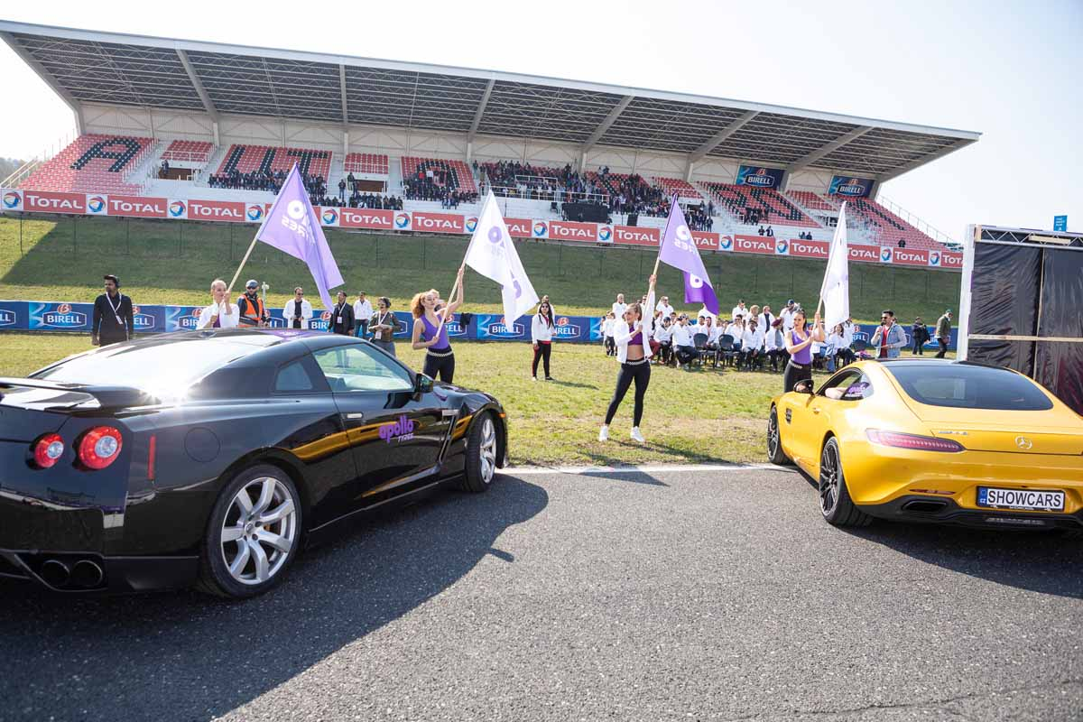 Czech hostesses with Nissan GTR and Mercedes sports cars during big incentive event near Prague