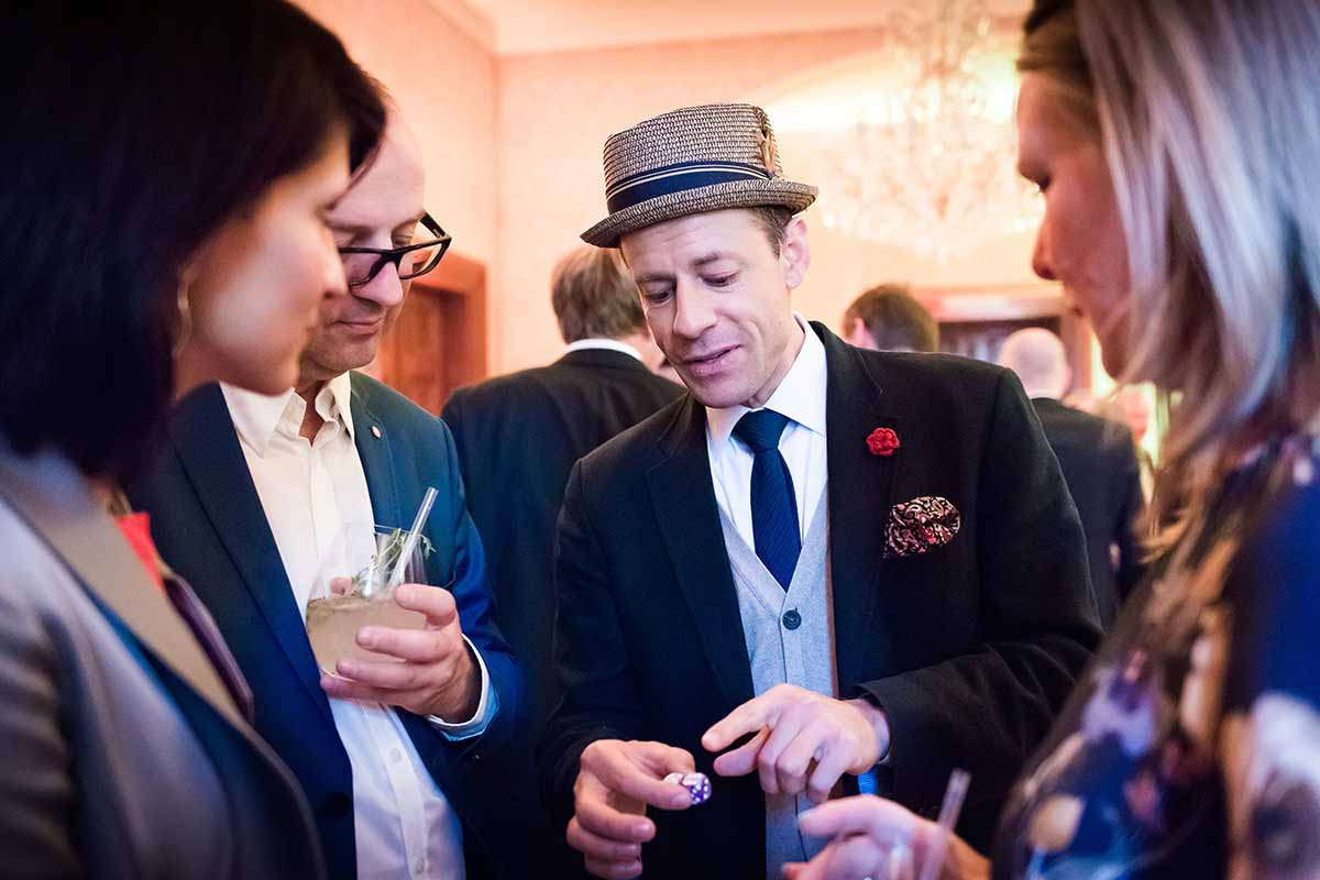 Experienced magician entertains guests during annual event professionally organized in Prague