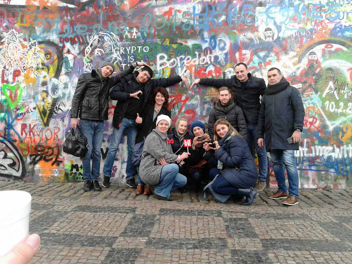 Participants of the Catalyst Photopoly teambuilding by the Lennon Wall in Prague