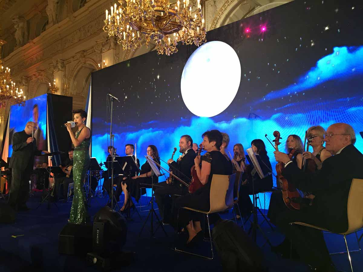 Professional orchestra and opera singer during private concert for a big incentive program organized in Prague