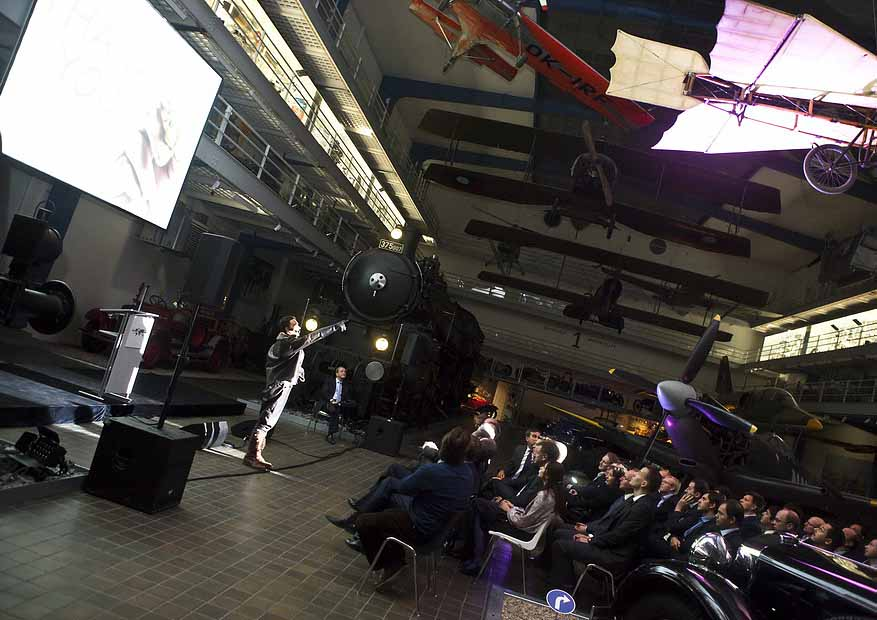 Speaker, stage and event guests in National Technical Museum event venue in Prague